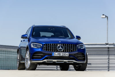 2020 MB GLC exterior front fascia and passenger side in empty parking lot with lamp post