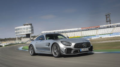 2020 MB AMG GT R PRO Coupe exterior front fascia and passenger side going fast on racetrack