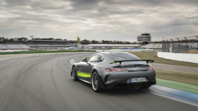 2020 MB AMG GT R PRO Coupe exterior back fascia and driver side going fast on blurred racetrack