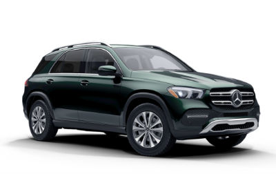 Emerald Green Metallic 2020 MB GLE exterior front fascia and passenger side on white background