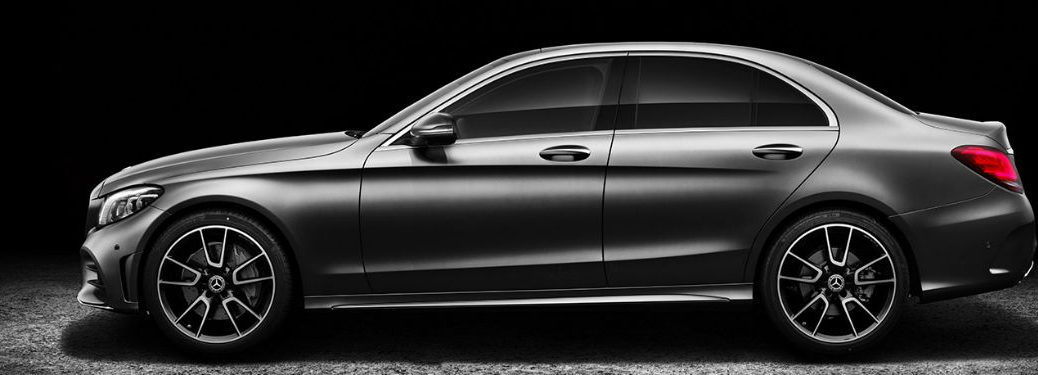 2019 MB C-Class Sedan exterior driver side profile with dramatic lighting
