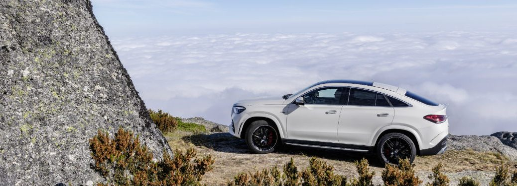 2021 MB AMG GLE exterior driver side profile on cliff overlooking clouds