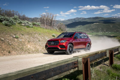 2020 MB GLS exterior front fascia and driver side going fast on dirt road