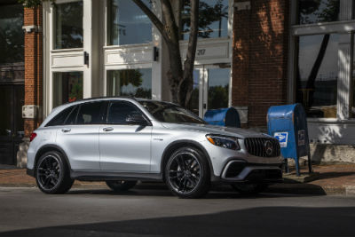 2018 MB GLC SUV exterior front fascia and passenger side in front of house with trees