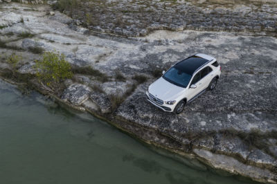 2020 MB GLE exterior top view and driver side on rocky edge with murky water
