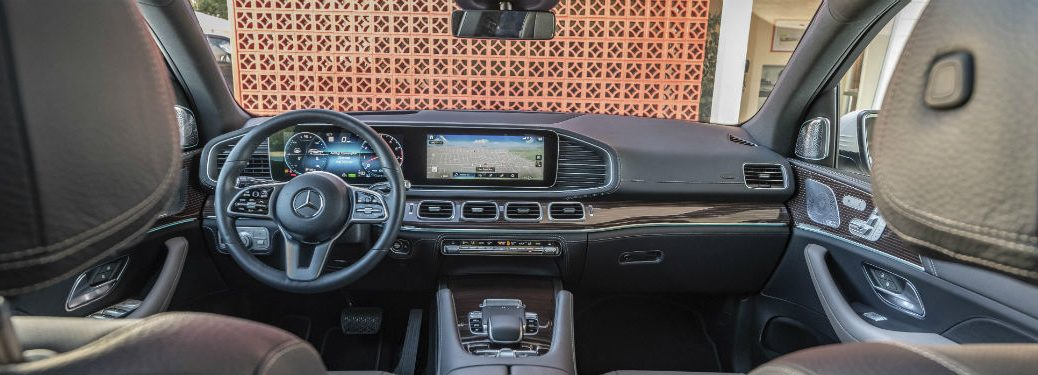 2020 MB GLE SUV interior front cabin looking past headrests to steering wheel and dashboard