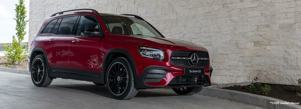 2020 Mercedes-Benz GLB exterior front fascia and passenger side in front of stone wall