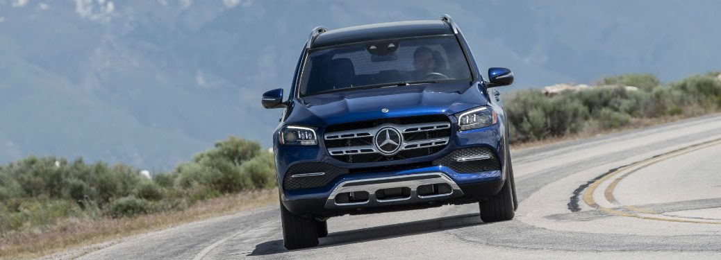 2020 MB GLS exterior front fascia driving on curving highway with mountains