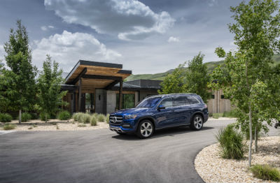 2020 MB GLS exterior front fascia and driver side in front of large house with trees