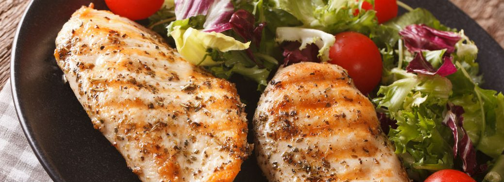 Grilled chicken with salad and grape tomatoes