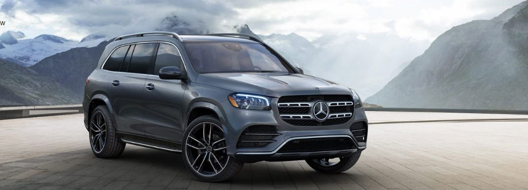 2020 MB GLS exterior front fascia and passenger side with mountain background