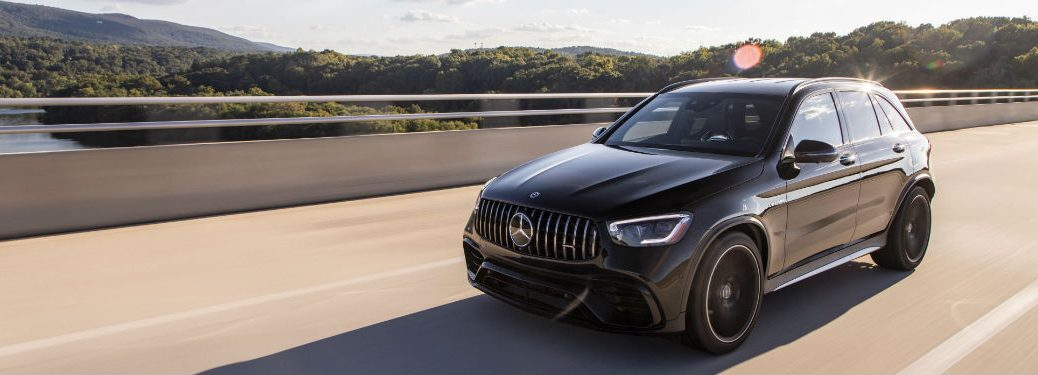 2020 MB GLC exterior front fascia and driver side going fast on blurred highway next to river
