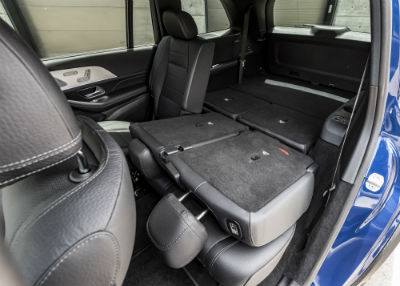 2020 MB GLS interior looking from passenger door to folded driver side back seat