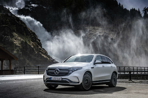 2020 MB EQC exterior front fascia and driver side in front of waterfall