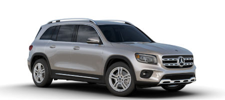 Mojave Silver metallic 2020 MB GLB exterior front fascia and passenger side on white background