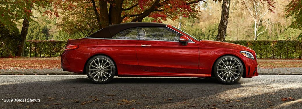 2020 MB C-Class Cabriolet exterior passenger side profile on road in fall