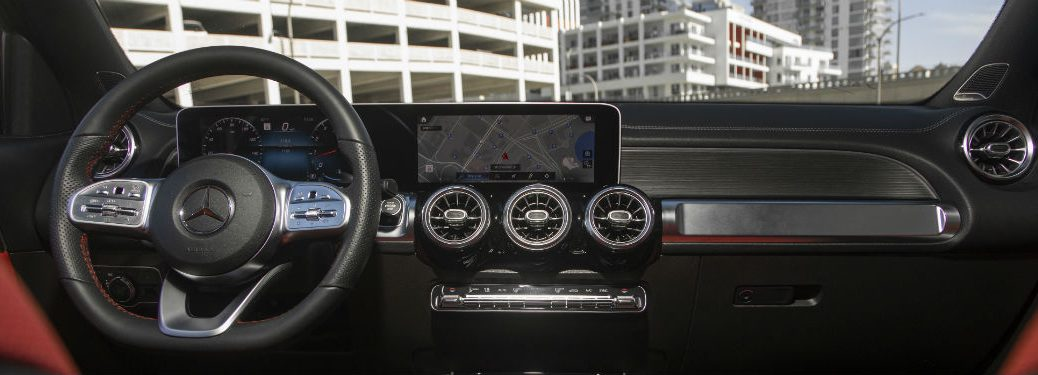 2020 MB GLB interior front cabin steering wheel dashboard on top of parking garage in city