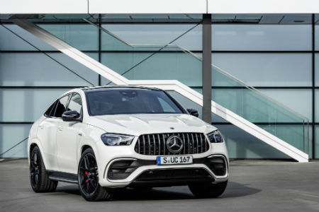 2021 MB AMG GLE 63 S Coupe exterior front fascia passenger side in front of building windows