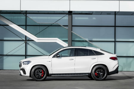 2021 MB AMG GLE 63 S Coupe exterior driver side profile in front of building windows