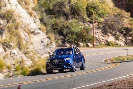 2020 MB GLE exterior front fascia driver side on winding hillside highway