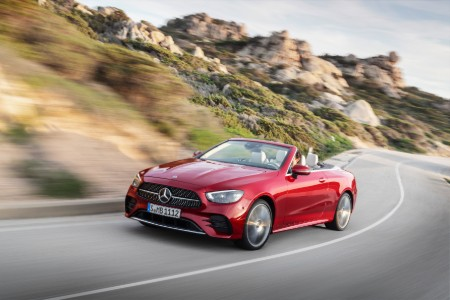 2021 MB E-Class Cabriolet exterior front fascia driver side on blurred highway