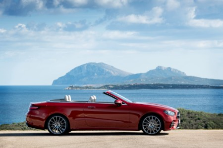 2021 MB E-Class Cabriolet passenger side profile in front of lake with mountian