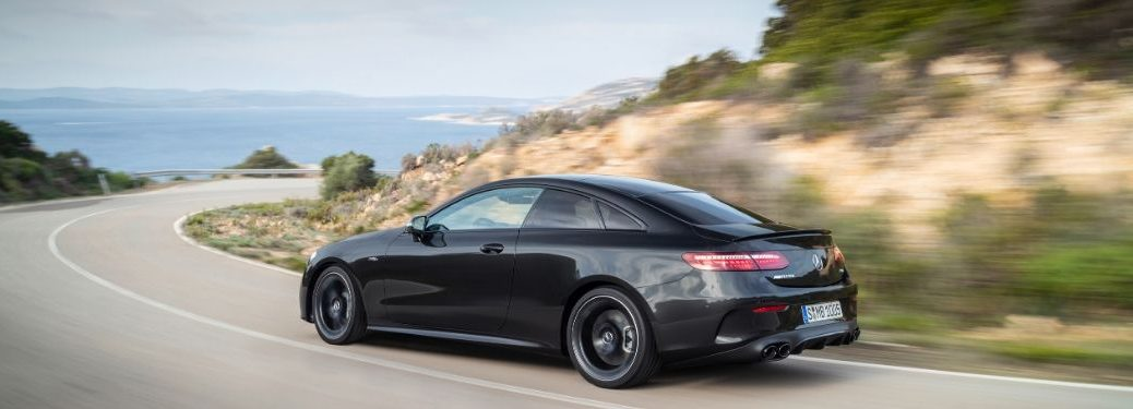 2021 MB E-Class Coupe exterior rear fascia driver side on blurred highway