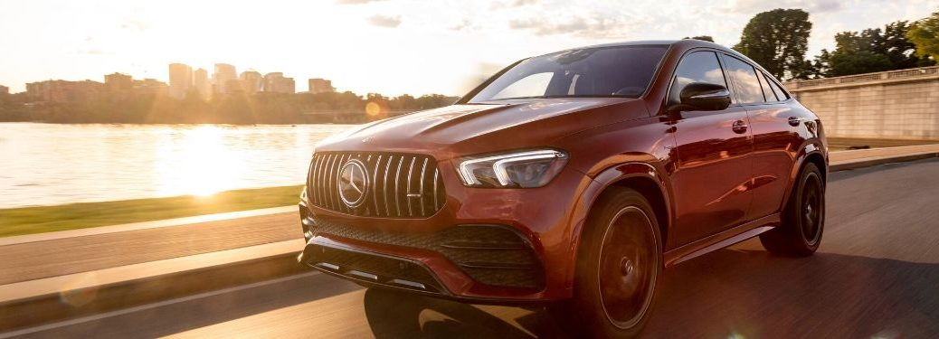 2021 MB AMG GLE Coupe exterior front fascia driver side next to lake with sunset