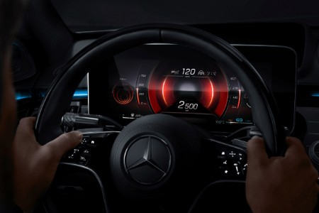 2021 MB S-Class interior steering wheel with hands on it and digital display lit in red