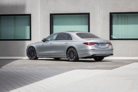 2021 MB S-Class exterior rear fascia driver side in front of concrete wall with windows