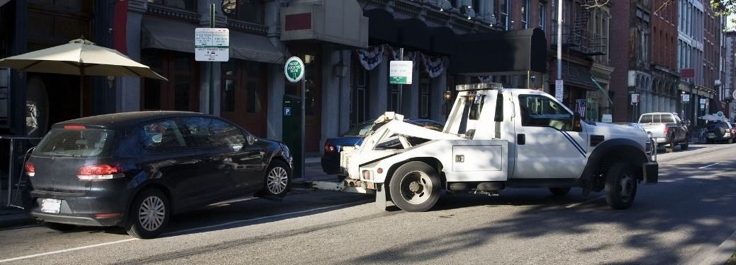 Car getting towed in the city