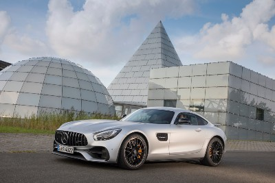 2020 MB GT S Coupe exterior front fascia driver side in front of glass buildings