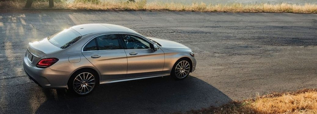 2021 MB C-Class exterior rear fascia passenger side on empty road