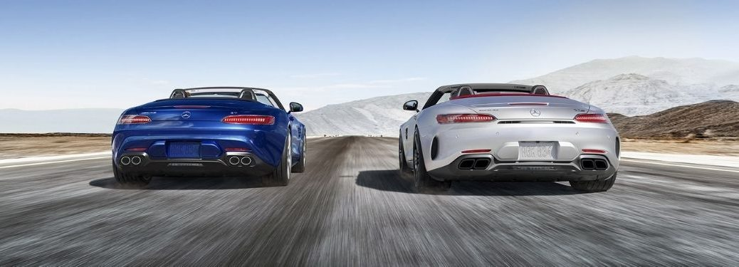 2021 MB GT Roadster extrior rear fascia of 2 models on blurred highway