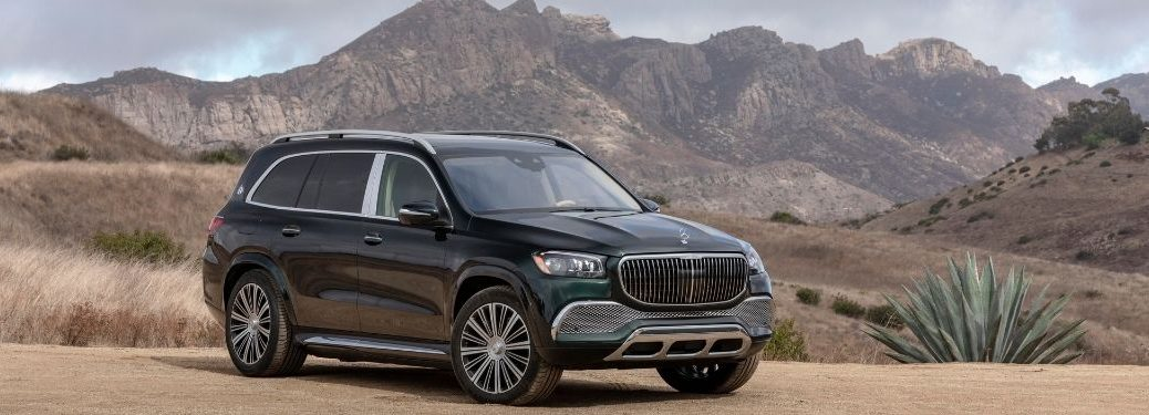2021 MB GLS exterior front fascia passenger side in front of mountains