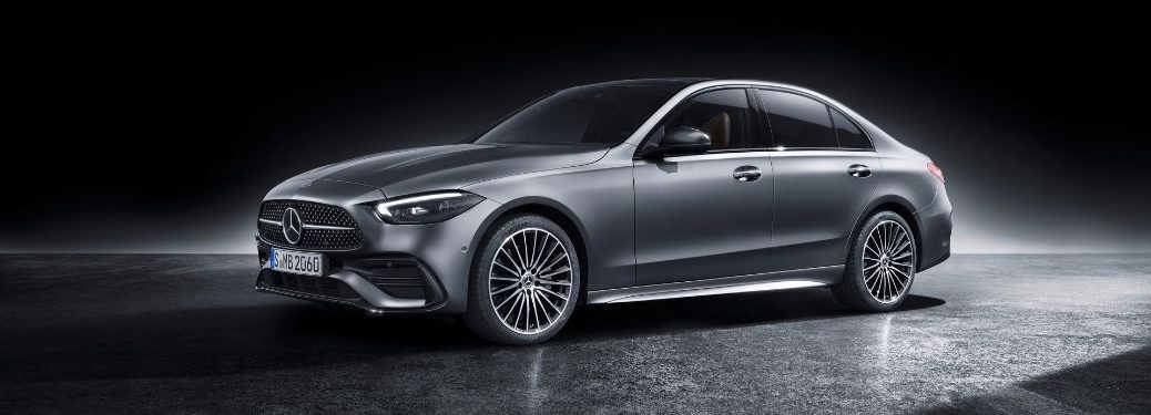 2022 MB C-Class exterior front fascia driver side with dramatic lighting
