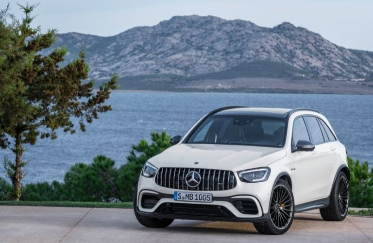 2022 MB GLC exterior front fascai driver side in front of water and mountain