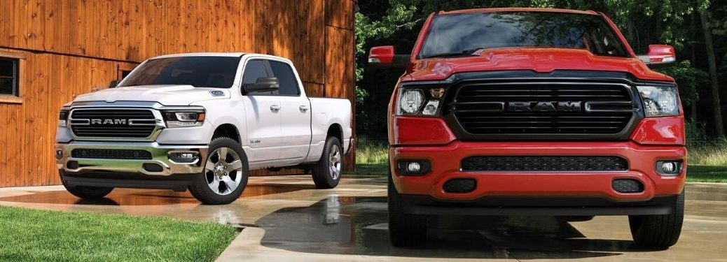 White and Red 2020 Ram 1500 Trucks in a Driveway