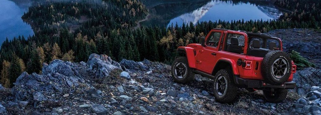 2020 Jeep Wrangler red back view over a lake