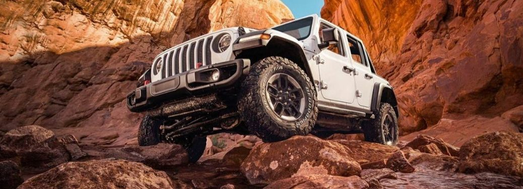 White 2020 Jeep Wrangler Front Exterior on Rocky Trail