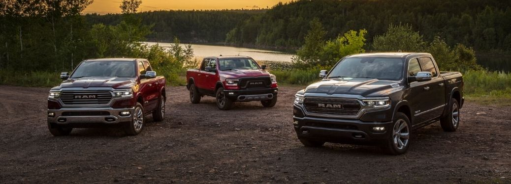 Red and Black 2020 Ram 1500 Models Next to a Lake at Sunset