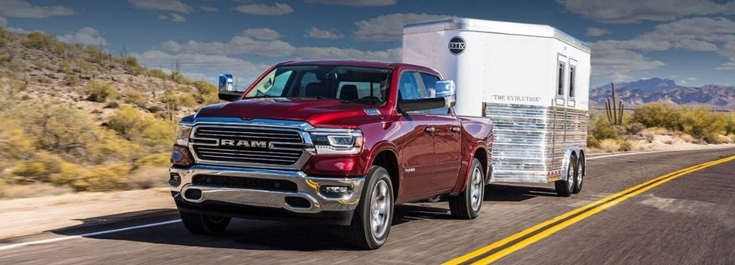 Red 2020 Ram 1500 Towing a Trailer on a Desert Road