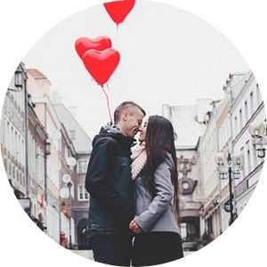 Couple Kissing on a City Street with Red Heart Balloons