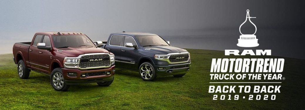 Red and Blue 2020 Ram Heavy Duty Trucks in Grass with White MotorTrend Truck of the Year Graphic