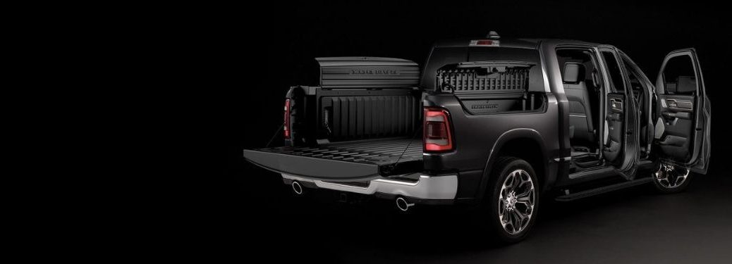 Black 2020 Ram 1500 Rear Exterior on Black Background with Doors, Tailgate and Ram Cargo Box Open