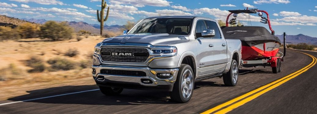 Silver 2020 Ram 1500 Towing a Boat in the Desert
