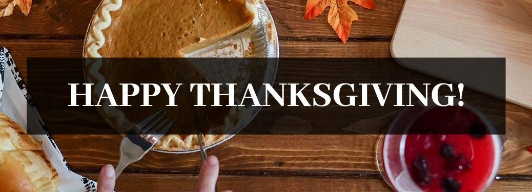 Pumpkin Pie and Food on a Table with Black Text Box and White Happy Thanksgiving! Text