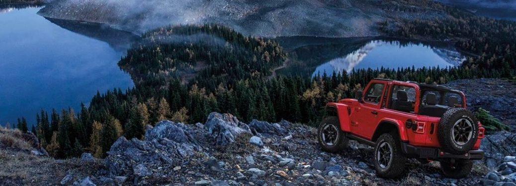 Red 2020 Jeep Wrangler Overlooking a Mountain Lake