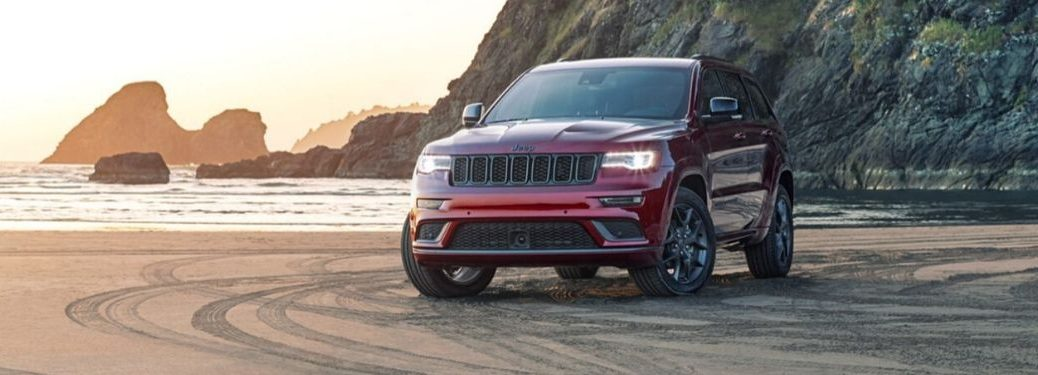Red 2020 Jeep Grand Cherokee on a Beach