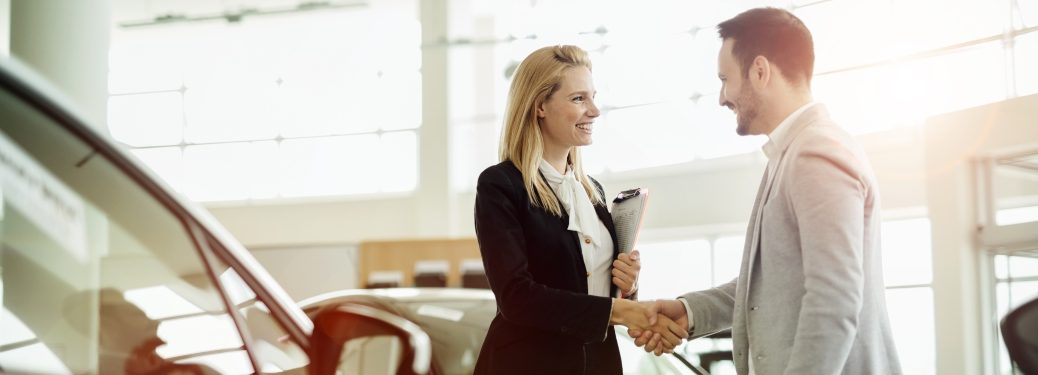 man and sales woman shaking hands